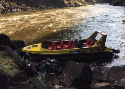 Shearwater jet boat on the river bank