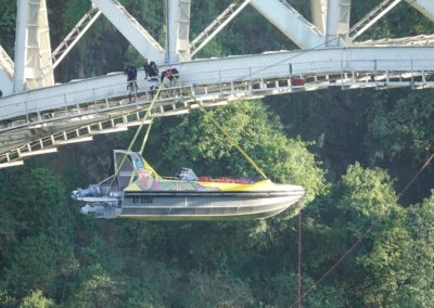 Shearwater jet boat being lowered into the river